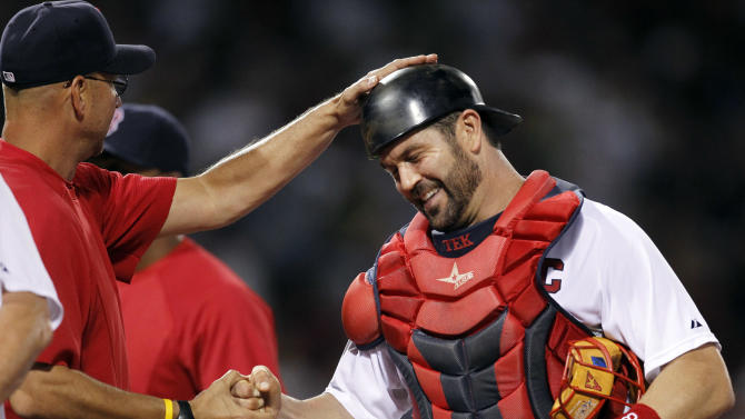 FILE - In this July 5, 2011 file photo, Boston Red Sox's manager Terry Francona, left, celebrates with Red Sox catcher Jason Varitek, right, moments after defeating the Toronto Blue Jays 3-2 in a baseball game at Fenway Park, in Boston. For 15 years, Varitek was the voice in the Boston pitching staff's ear, and the target behind the plate, giving the Red Sox their hard-nosed, gritty identity that they used to win two World Series titles.  Now, it appears that era has come to an end.  (AP Photo/Steven Senne, File)