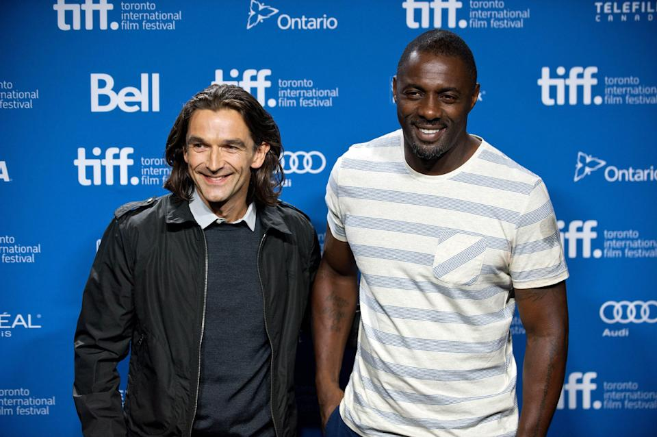 "Director Justin Chadwick, left, poses with actor Idris Elba during the photo call for ""Mandela: Long Walk to Freedom"" at the 2013 Toronto International Film Festival in Toronto on Sunday, Sept. 8, 2013. (AP Photo/The Canadian Press, Galit Rodan)"