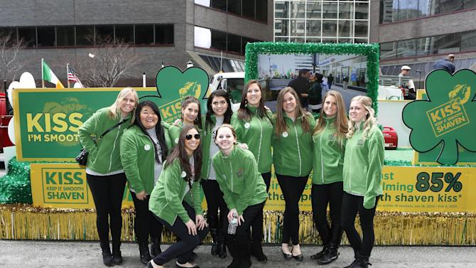 """Gillette Brand Ambassadors pose in front of the """"Kiss Me, I'm Smooth Shaven!"""" Gillette float at the St. Patrick's Day Parade, reminding guys to K.I.S.S. - Keep It Smooth Shaven - on Sunday, March 10, 2013 in Philadelphia. A recent study revealed that 85% of women prefer to kiss a man who is smooth shaven, and that two out of three women said men will have better luck with them if they are stubble-free. (Photo by Mark Stehle/Invision for Gillette/AP Images)"""