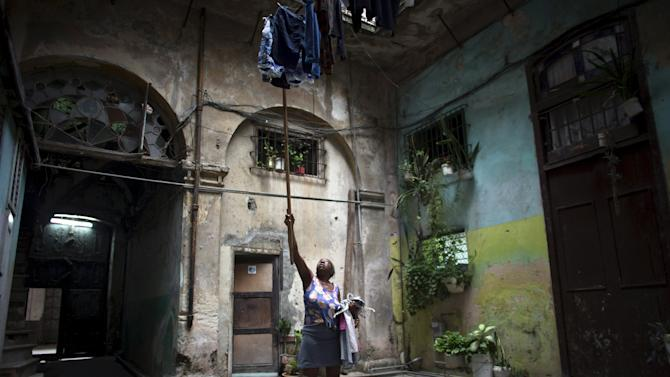 Pedroso hangs clothes at the courtyard of her home in downtown Havana