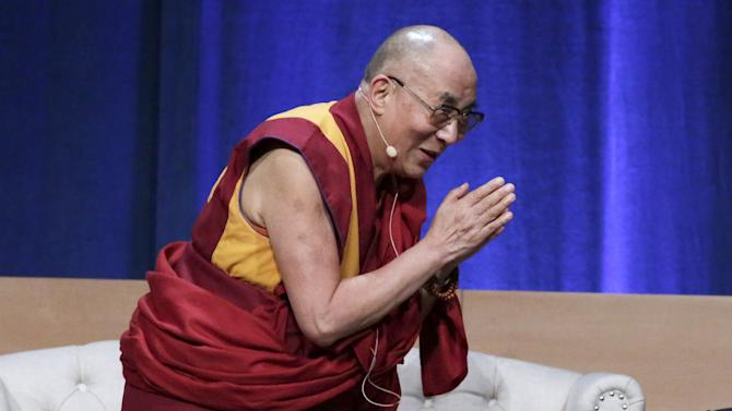The Dalai Lama bows while speaking at the University of California, Irvine