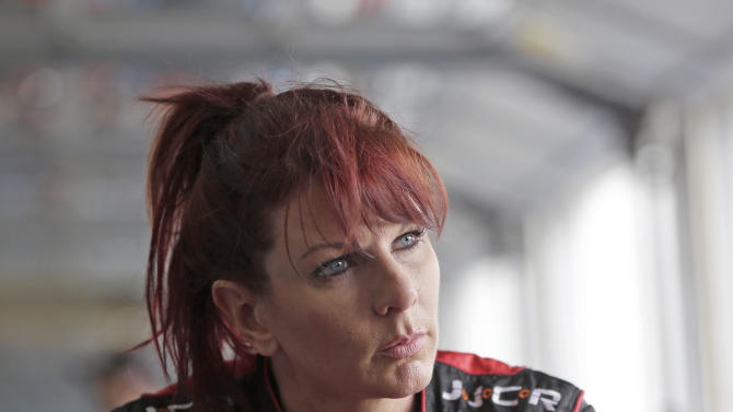 Jennifer Jo Cobb talks to crew members before practice for the NASCAR Truck series North Carolina Education Lottery 200 auto race at Charlotte Motor Speedway in Concord, N.C., Thursday, May 16, 2013. After having her trailer stolen, truck racer Jennifer Jo Cobb is hoping to find replacement equipment in time to race this weekend. (AP Photo/Chuck Burton)