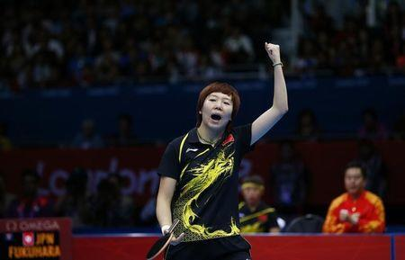 China's Li Xiaoxia celebrates after defeating Japan's Ai Fukuhara in their women's team gold medal table tennis singles match at the ExCel venue during the London 2012 Olympic Games
