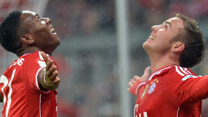 Munich's David Alaba, left, and Mario Goetze celebrate a goal during the German Bundesliga soccer match between FC Bayern Munich and Eintracht Frankfurt, in Munich, Germany, Sunday Feb. 2, 2014. (AP Photo/dpa, Peter Kneffel)