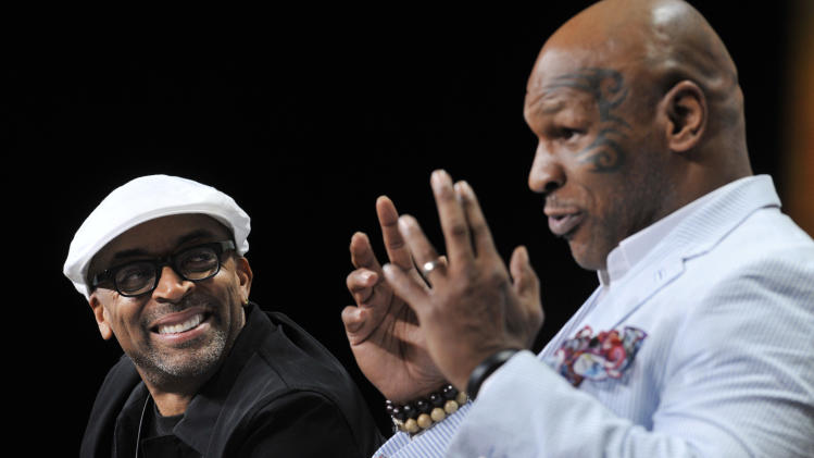 "Spike Lee, left, director of ""Mike Tyson: Undisputed Truth,"" listens as Tyson answers a question during HBO's Summer 2013 TCA panel at the Beverly Hilton Hotel on Thursday, July 25, 2013, in Beverly Hills, Calif. (Photo by Chris Pizzello/Invision/AP)"