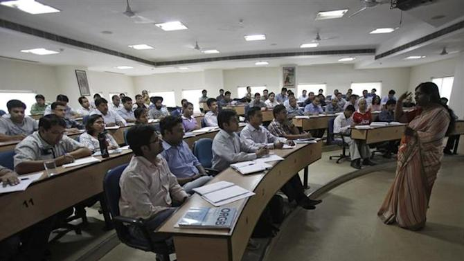 Students attend a lecture at a classroom at an institute in Gurgaon, on the outskirts of New Delhi May 2, 2012. REUTERS/Adnan Abidi/Files
