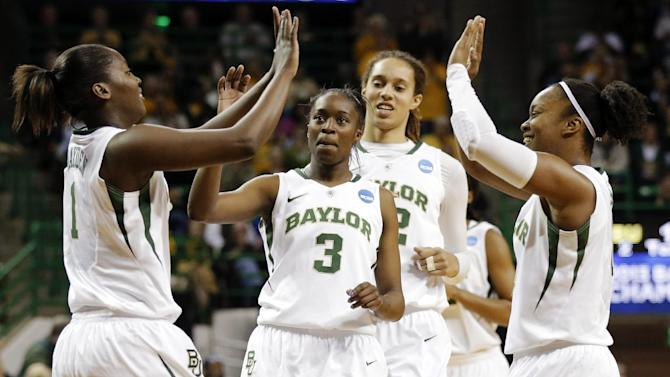 Baylor's Kimetria Hayden (1), Jordan Madden (3), Brittney Griner, rear, and Odyssey Sims, right, celebrate a score in the second half of a first-round game against Prairie View A&M in the women's NCAA college basketball tournament, Sunday, March 24, 2013, in Waco, Texas. Baylor won 82-40. (AP Photo/Tony Gutierrez)