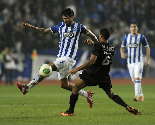 FC Porto's Lucho Gonzalez, from Argentina, drives the ball past Academica's Djavan Ferreira, right, from Brazil in a Portuguese League soccer match at the Municipal Stadium in Coimbra, Portugal, Satur