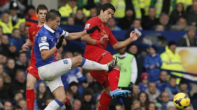 The cause of the controversy: Everton's Kevin Mirallas puts in a heavy challenge on Liverpool's Luis Suarez (Reuters)