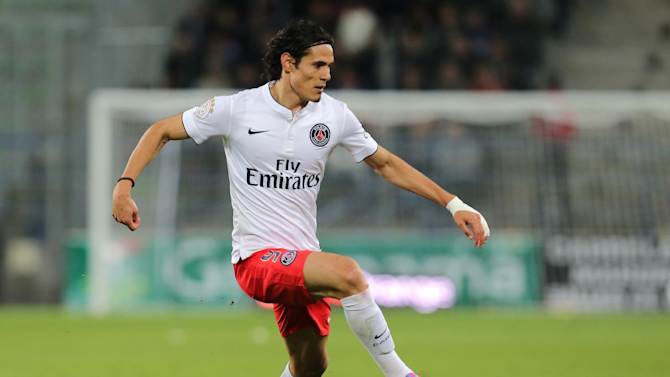 Paris Saint Germain's forward Edinson Cavanni of Uruguay run with the ball on the field during his League One soccer match against Caen, in Caen, western France, Wednesday, Sept. 24, 2014. (AP Photo/David Vincent)