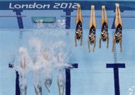 Japan&#39;s women&#39;s synchronized swimming team start their technical routine at the Aquatics Centre in the Olympic Park during the 2012 Summer Olympics in London, Thursday, Aug. 9, 2012. (AP Photo/Tim Donnelly)