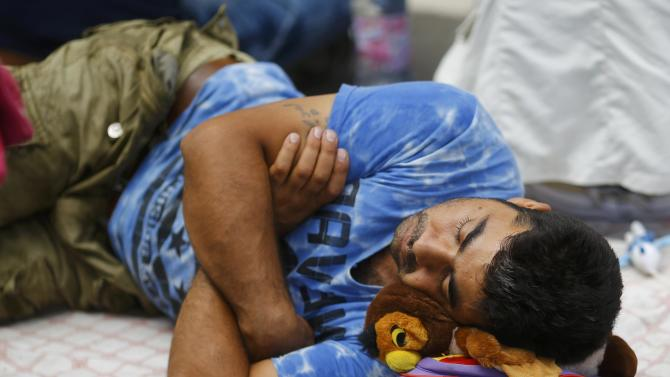 A migrant sleeps near the Keleti railway station in Budapest