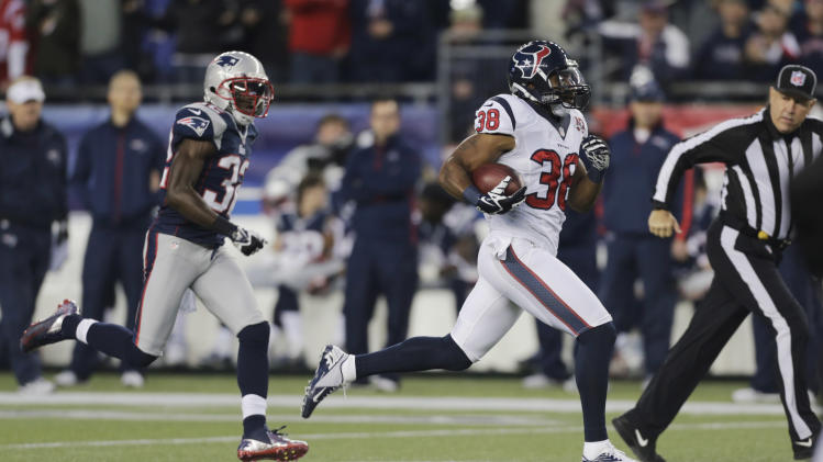 Houston Texans free safety Danieal Manning is chased by New England Patriots free safety Devin McCourty, left, on a 94-yard kickoff return during the first half of an AFC divisional playoff NFL football game in Foxborough, Mass., Sunday, Jan. 13, 2013. (AP Photo/Charles Krupa)