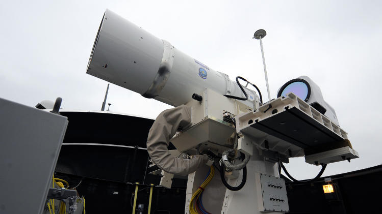 In this July 30, 2012 photo provided by the U.S. Navy, a laser weapon sits temporarily installed aboard the guided-missile destroyer USS Dewey in San Diego. The Navy plans to deploy its first laser on a ship in 2014, and intends to test an electromagnetic rail gun prototype aboard a vessel within the following two years. (AP Photo/U.S. Navy, John F. Williams)