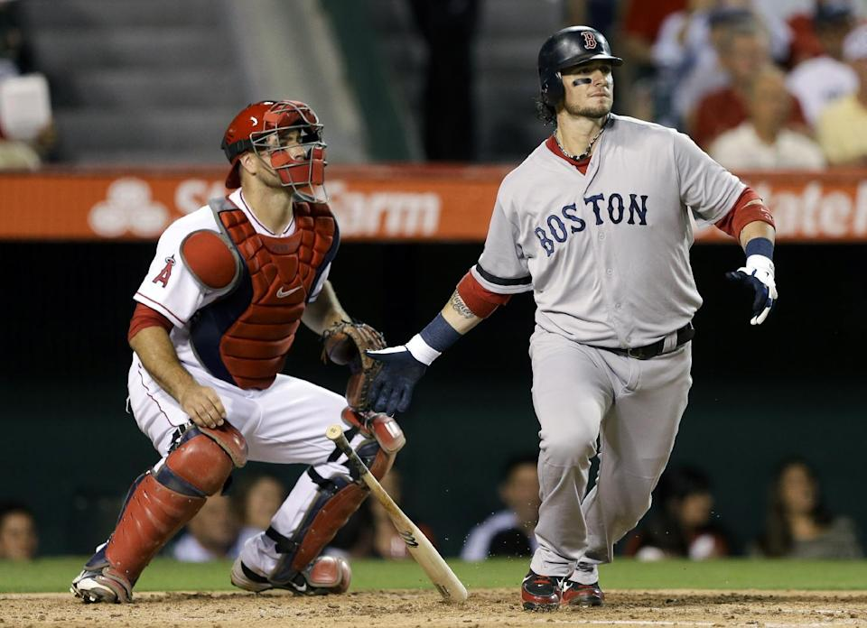 Boston Red Sox's Jarrod Saltalamacchia, right, watches his RBI-single against the Los Angeles Angels during fourth inning of a baseball in Anaheim, Calif., Tuesday, Aug. 28, 2012. (AP Photo/Chris Carlson)
