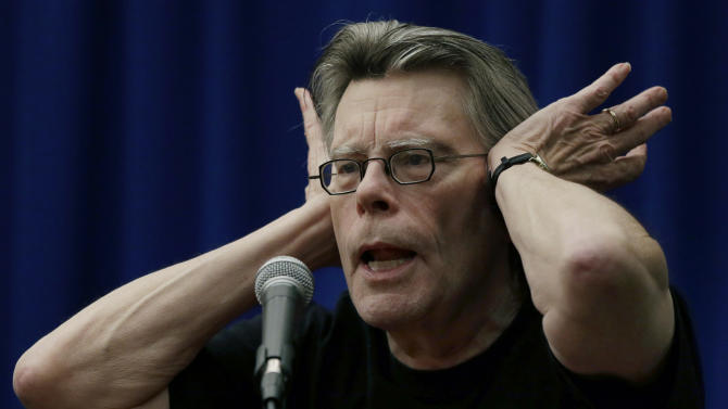 Novelist Stephen King gestures as he speaks to creative writing students at the University of Massachusetts-Lowell in Lowell, Mass., Friday, Dec. 7, 2012. (AP Photo/Elise Amendola)