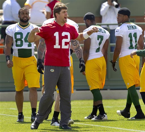 Rodgers becomes a tutor for QB Harrell
