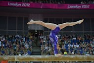 US gymnast Jordyn Wieber performs on the beam during the women's qualification of the artistic gymnastics event of the London Olympic Games at the 02 North Greenwich Arena in London