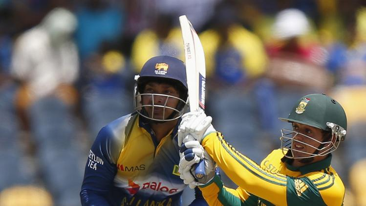 South Africa's de Kock plays a shot next to Sri Lanka's Sangakkara during their final One Day International cricket match in Hambantota