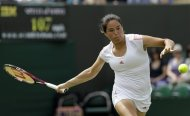 Jamie Lee Hampton of the United States returns a shot to Heather Watson of Britain during a second round women&#39;s singles match at the All England Lawn Tennis Championships at Wimbledon, England, Wednesday, June 27, 2012. (AP Photo/Alastair Grant)