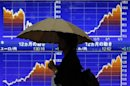 Asian shares hit 2013 lows, Nikkei volatile on BOJ jitters