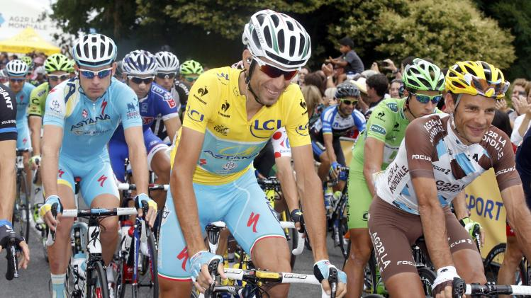 Race leader and yellow jersey holder Nibali rides with Peraud during the 18th stage of theTour de France cycling race