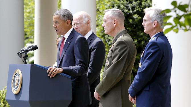 Obama, flanked by Biden, introduces Dunford as his nominee to be the next chairman of the Joint Chiefs of Staff, in the Rose Garden at the White House in Washington