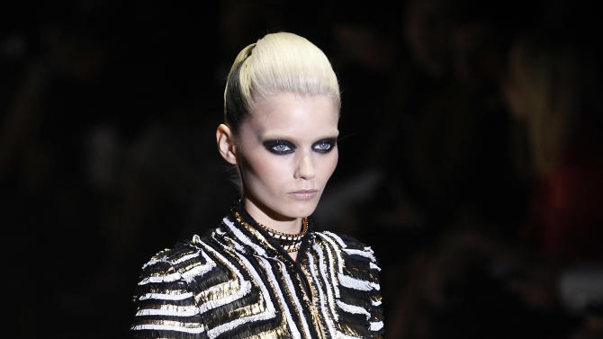 A model wears a creation part of the Gucci Spring-Summer 2012 fashion collection, during the fashion week in Milan, Italy, Wednesday, Sept. 21, 2011. (AP Photo/Antonio Calanni)