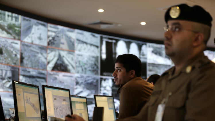 Saudi police officers monitor screens connected to cameras set up to monitor the huge crowds pilgrims at holy places in Mina in the Saudi holy city of  Mecca, Saudi Arabia, Saturday, Oct. 27, 2012. (AP Photo/Hassan Ammar)