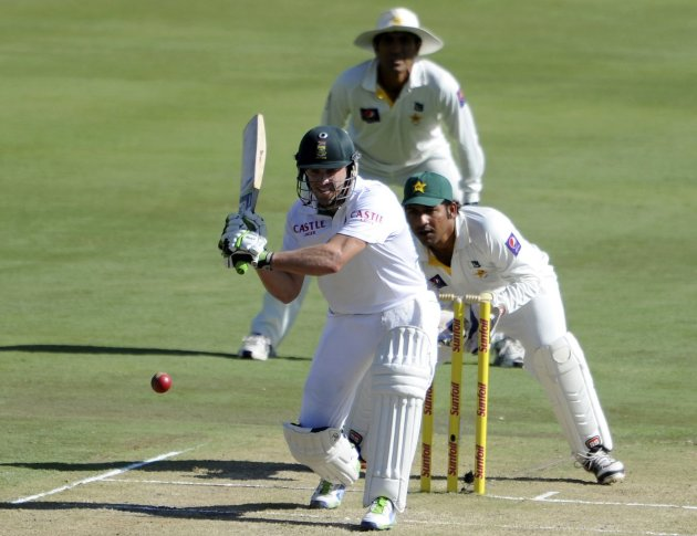 South African batsman AB de Villiers plays a shot as Pakistan's wicketkeeper Sarfraz Ahmed looks on during the first day of the third cricket test match in Pretoria
