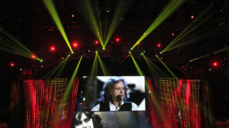 Donovan Leitch performs after his induction into the Rock and Roll Hall of Fame Saturday, April 14, 2012, in Cleveland. (AP Photo/Tony Dejak)