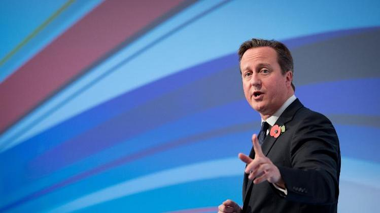 British Prime Minister David Cameron addresses delegates at the Confederation of British Industry's (CBI) annual conference in central London, on November 4, 2013
