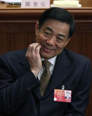 Bo Xilai, the party chief of Chongqing scratches his face during the opening session of the National People's Congress at Beijing's Great Hall of the People, in China, Monday, March 5, 2012. China's political elite gathered for their most public meetings of the year with an uncomfortable scandal tainting Bo a leading politician and roiling the ruling Communist Party's plans for a smooth transition to a new leadership. (AP Photo/Ng Han Guan)