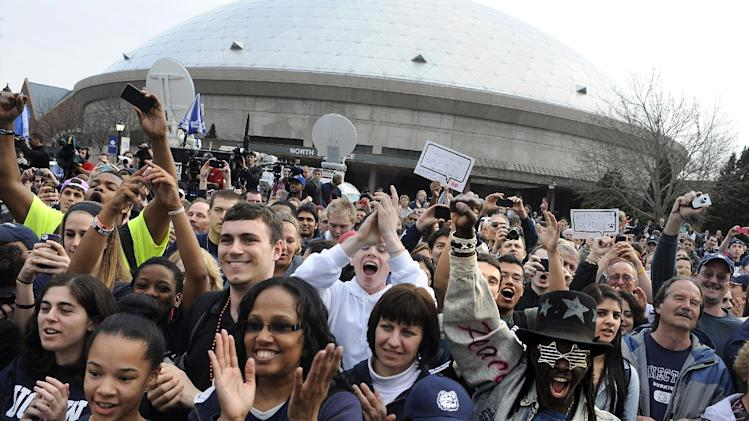 Fans cheer outside Gampel Pavilion during a rally and parade through campus honoring the team's win in the women's NCAA Final Four college basketball championship in Storrs, Conn., Wednesday, April 10, 2013. (AP Photo/Jessica Hill)