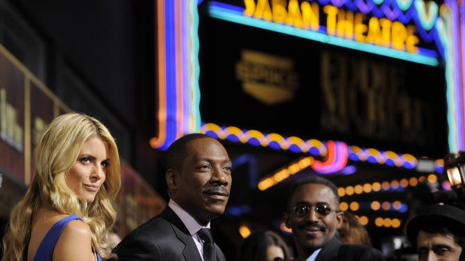 "Eddie Murphy, second from left, arrives with his date Paige Butcher at ""Eddie Murphy: One Night Only,"" a celebration of Murphy's career at the Saban Theater on Saturday, Nov. 3, 2012, in Beverly Hills, Calif. (Photo by Chris Pizzello/Invision)"