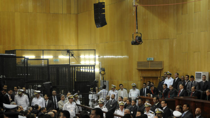 FILE - In this Saturday, June 2, 2012 file photo, people gather inside a courtroom to hear a verdict in the trial of former Egyptian President Hosni Mubarak, his sons and several security officers in Cairo, Egypt, Saturday, June 2, 2012. A verdict sentencing more than 520 people to death on Monday, March 24, 2014 after a cursory mass trial has drawn new attention on Egypt's judiciary, where many judges are strong backers of the military and sharp opponents of Islamists, operating amid a media frenzy calling for swift and harsh verdicts against the Muslim Brotherhood.(AP Photo, File)