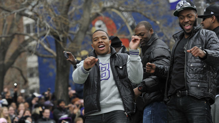 Baltimore Ravens running back Ray Rice, left, dances on a float with other players during a victory parade Tuesday, Feb. 5, 2013, in Baltimore. The Ravens defeated the San Francisco 49ers in NFL football's Super Bowl XLVII 34-31 on Sunday. (AP Photo/Gail Burton)