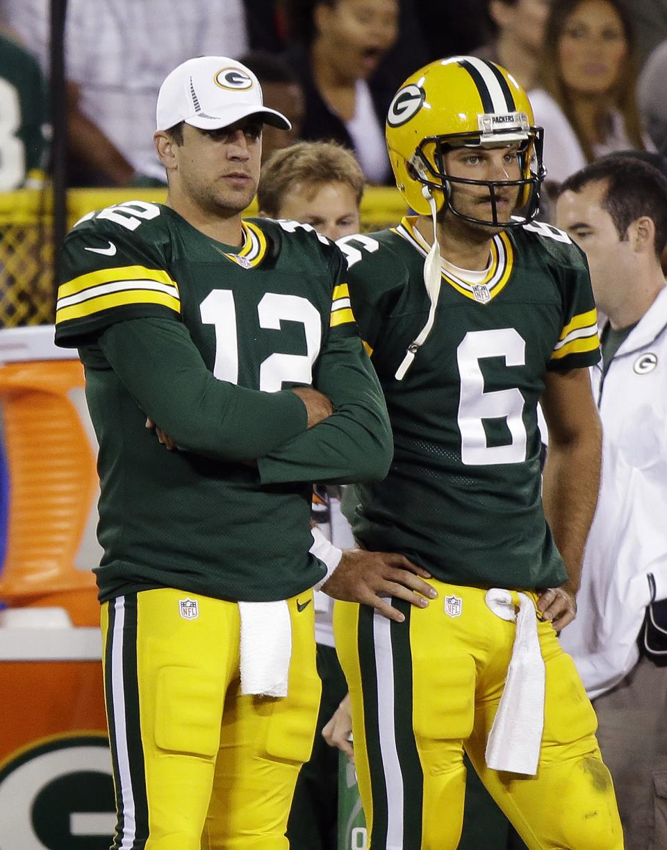 Green Bay Packers quarterback Aaron Rodgers (12) stands with quarterback Graham Harrell (6) on the sidelines during the second half of a preseason NFL football game against the Cleveland Browns Thursday, Aug. 16, 2012, in Green Bay, Wis. (AP Photo/Morry Gash)