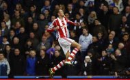 Peter Crouch of Stoke City celebrates scoring against Chelsea during their English Premier League soccer match at the Britannia Stadium in Stoke-on-Trent, central England, December 7, 2013. REUTERS/Andrew Winning