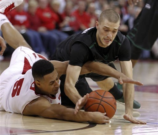 Evans, Wisconsin rally to beat Green Bay 65-54
