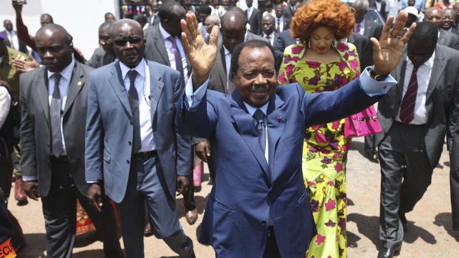 FILE -  In this Oct. 9, 2011 file photo, Cameroon President Paul Biya waves after casting his vote during presidential elections in Yaounde, Cameroon. The party of Cameroon's entrenched ruler won 56 of the 70 contested seats in the nation's first-ever senatorial election, the Supreme Court announced Monday, April 29, 2013. According to the constitution, the 80-year-old Biya, in power since 1982, gets to appoint the remaining 30 members of the legislative body, ensuring total control of the newly-created 100-seat Senate.(AP Photo/Sunday Alamba, File)