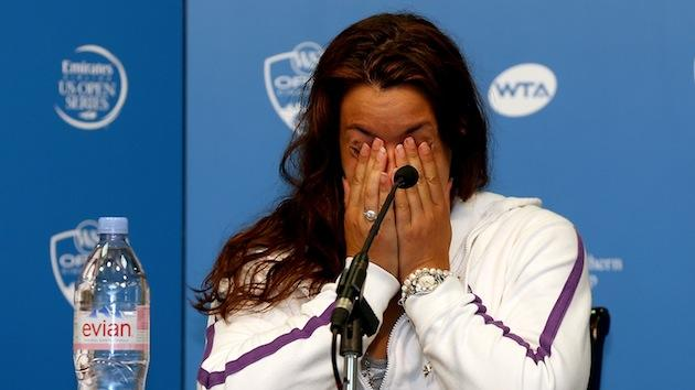 Wimbledon champion Marion Bartoli shocks the tennis world with her retirement announcement