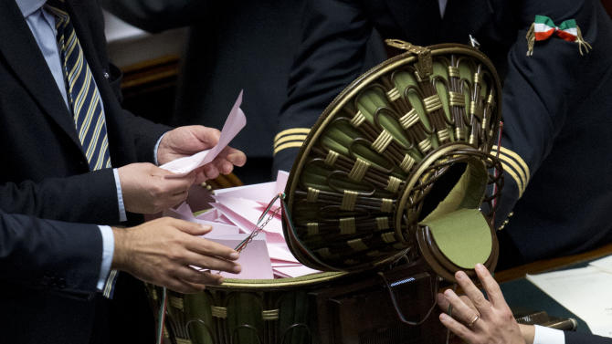 Ushers prepare to count ballots during a vote on a new president whose first job will be to seek the formation of a new government after inconclusive elections, in Rome Friday, April 19, 2013. Italy's Parliament has opened a third round of voting for the nation's president after two inconclusive votes a day earlier. In a bid to change the dynamic during Friday's voting, the center-left leader proposed former Premier Romano Prodi for the post. However, Silvio Berlusconi's center-right has already signaled its opposition to the man who twice beat Berlusconi in national elections. (AP Photo/Andrew Medichini)