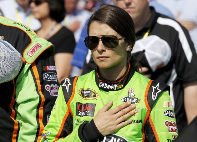Danica Patrick stands during the national anthem before climbing into her number 10 car to start the first NASCAR Sprint Cup Series Budweiser Duel at the Daytona International Speedway in Daytona Beac