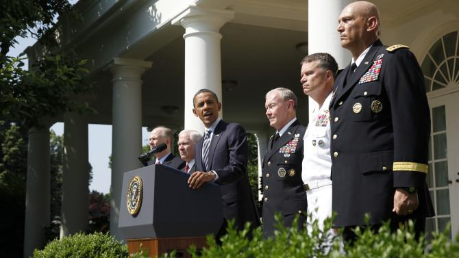 President Barack Obama introduces his choice for next Chairman of the Joint Chiefs of Staff, Army Gen. Martin Dempsey, third from right, the next vice chairman of the Joint Chiefs of Staff Adm. James Winnefeld and Gen. Ray Odierno, right, to be Army Chief of Staff during a Rose Garden announcement at the White House in Washington, Monday, May 30, 2011. Also pictured are National Security Adviser Tom Donilon, far left, and Defense Secretary Robert Gates, second left. (AP Photo/Charles Dharapak)