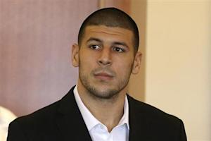 Aaron Hernandez, former player for the NFL's New England Patriots football team, stands during his arraignment in the Bristol County Superior Court in Fall River
