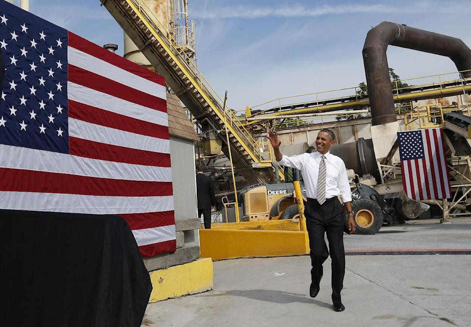 President Barack Obama waves as he arrives to speak about the government shutdown and debt ceiling during a visit to M. Luis Construction, which specializes in asphalt manufacturing, concrete paving, and roadway reconstruction, Thursday, Oct. 3, 2013, in Rockville, Md. (AP Photo/Charles Dharapak)