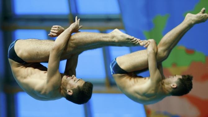 Spain's Nicolas Garcia and Hector Garcia perform during the men's synchronised 3 metre springboard preliminary at the Aquatics World Championships in Kazan