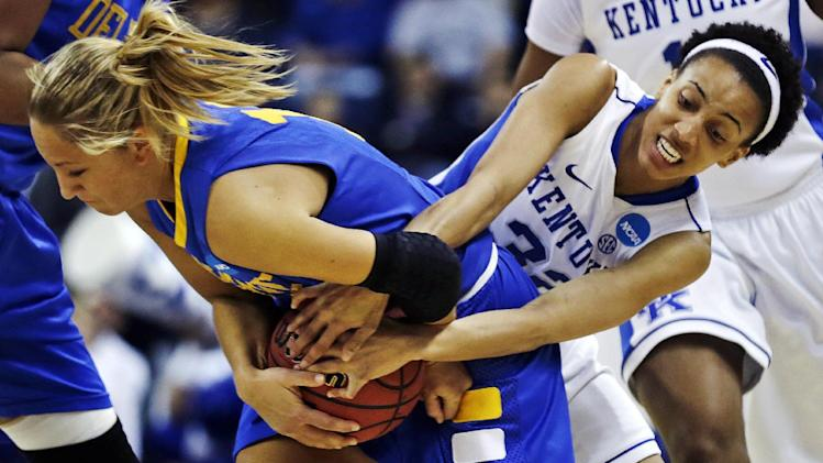Kentucky guard Kastine Evans, right, wrestles Delaware guard Kayla Miller for the ball during the first half of a women's NCAA college basketball regional semifinal in Bridgeport, Conn., Saturday, March 30, 2013. (AP Photo/Charles Krupa)