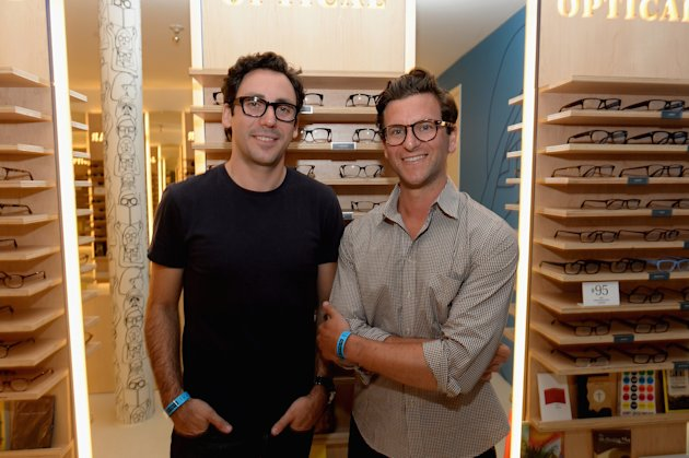 LOS ANGELES, CA - AUGUST 15: Warby Parker co-founders Neil Blumenthal (L) and Dave Gilboa attend Warby Parker's store opening in The Standard, Hollywood on August 15, 2013 in Los Angeles, California. (Photo by Michael Buckner/Getty Images for Warby Parker)